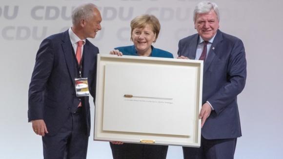 CDU-Bundesgeschäftsführer Klaus Schüler, die scheidende Vorsitzende Angela Merkel, ihr Stellvertreter Volker Bouffier und der Taktstock